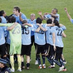 Uruguay's players celebrate after winning their Copa America final soccer match against Paraguay in Buenos Aires
