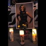Poster of Whitney Houston with candles at Whitney Houston Leimert Park Vigil on February 13, 2012 in Los Angeles, California. (Photo by Valerie MaconGetty Images)
